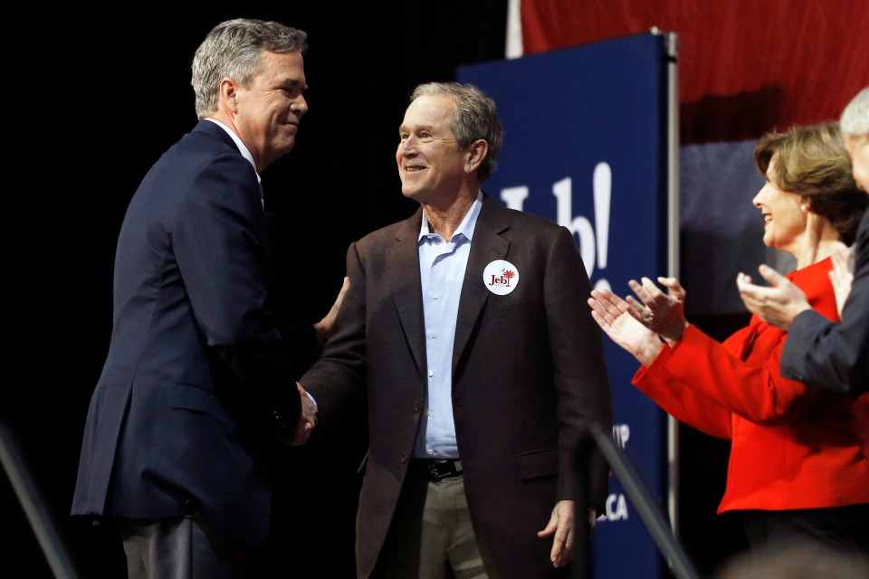 Republican presidential candidate and former Florida Gov. Jeb Bush, left, shakes hands with his brother former President George W. Bush as Laura Bush and Sen. Lindsey Graham, R-S.C., look on during a campaign stop Monday, Feb. 15, 2016, in North Charleston, S.C. (AP / Matt Rourke)