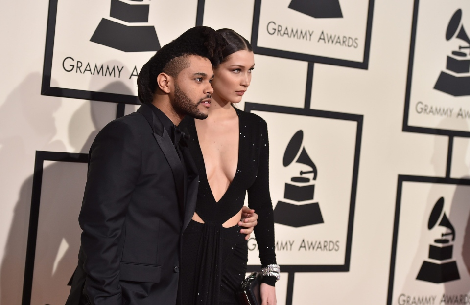 The Weeknd, left, and Bella Hadid arrive at the 58th annual Grammy Awards at the Staples Center on Monday, Feb. 15, 2016, in Los Angeles. (Jordan Strauss / Invision / AP)
