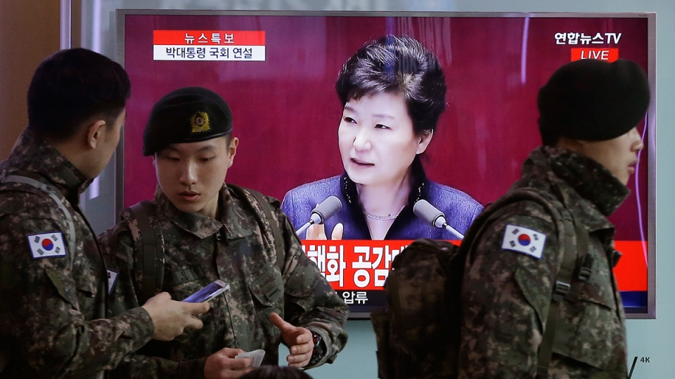 South Korean army soldiers pass by a TV screen showing the live broadcast of South Korean President Park Geun-hye's speech, at the Seoul Railway Station in Seoul, South Korea, Tuesday, Feb. 16, 2016. (AP / Ahn Young-joon)