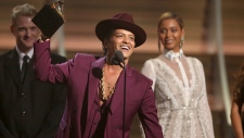 Bruno Mars accept the award for record of the year