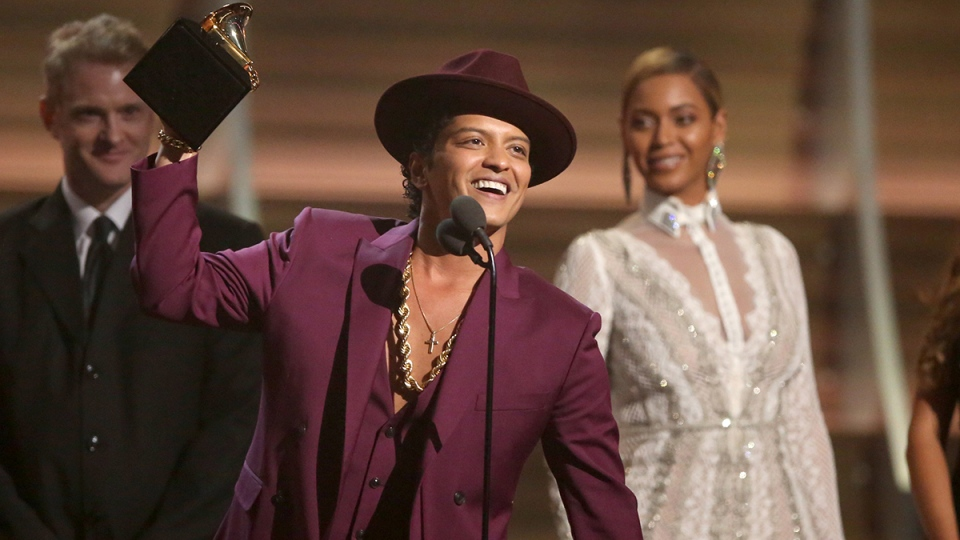 Bruno Mars accept the award for record of the year for 'Uptown Funk' at the 58th annual Grammy Awards on Monday, Feb. 15, 2016, in Los Angeles. (AP / Matt Sayles / Invision)
