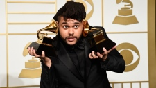 The Weeknd poses in the press room at the Grammys