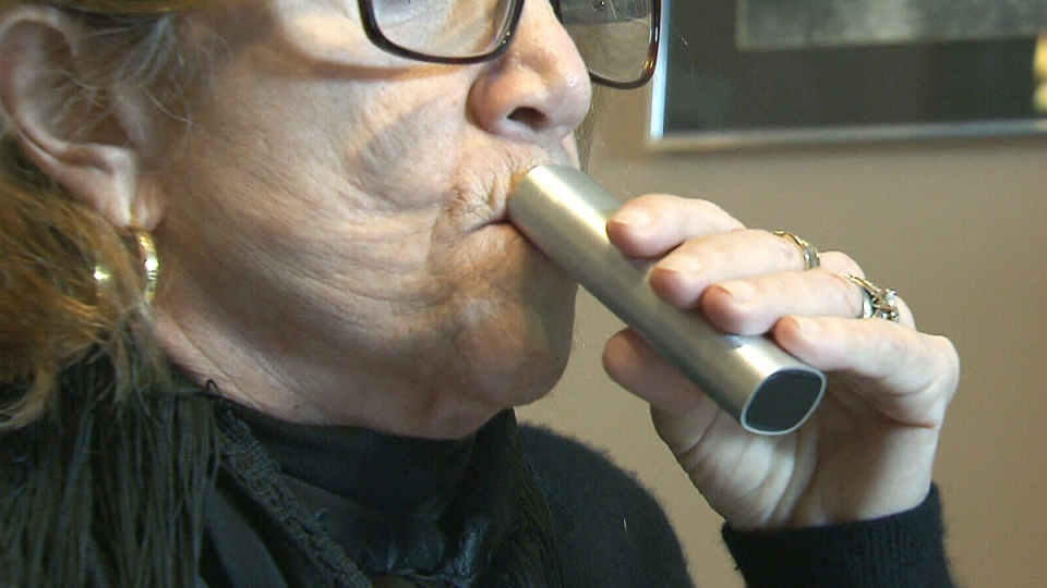 Fulvia Mrusek uses medical marijuana in a vapourizer at her home in Woodbridge, Ont.