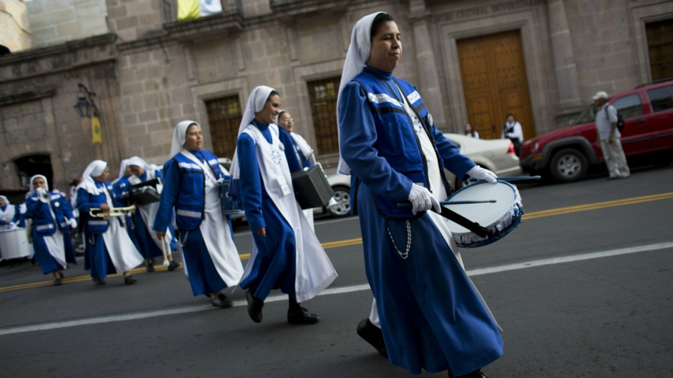 A marching band of nuns, from Monterrey, play their instruments as they spontaneously parade on the eve of Pope Francis' arrival, in Morelia, in the Mexican state of Michoacan on Monday, Feb. 15, 2016. (AP / Rebecca Blackwell)