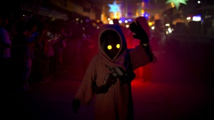 A youth sporting a Star Wars costume parades at the annual Alien Festival in Capilla del Monte, Cordoba, Argentina, the site of an alleged UFO sighting 30 years ago on Feb. 14, 2016. (AP / Natacha Pisarenko)