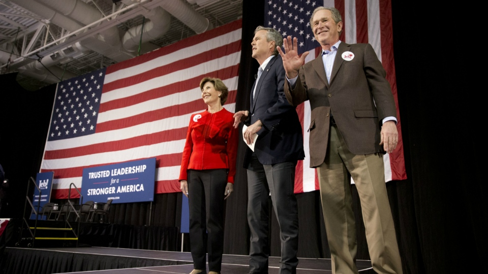 Republican presidential candidate and former Florida Gov. Jeb Bush, accompanied by his brother former President George W. Bush and George's wife Laura Bush, takes the stage during a campaign stop in North Charleston, S.C. on Monday, Feb. 15, 2016. (AP / Matt Rourke)