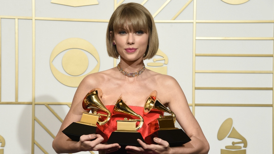 "Taylor Swift poses in the press room with the awards for album of the year for 1989, pop vocal album for 1989 and best music video for ""Bad Blood"" at the 58th annual Grammy Awards at the Staples Center in Los Angeles on Monday, Feb. 15, 2016. (Chris Pizzello / Invision)"