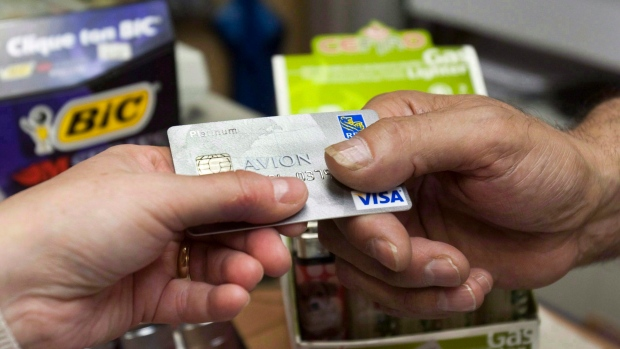 A consumer pays with a credit card at a store Tuesday, July 6, 2010 in Montreal. (THE CANADIAN PRESS/Ryan Remiorz)