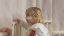 Toddler swallows battery
