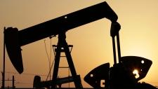 In this Sept. 30, 2015, file photo, oil pumps work in the desert oil fields of Sakhir, Bahrain. (AP / Hasan Jamali)