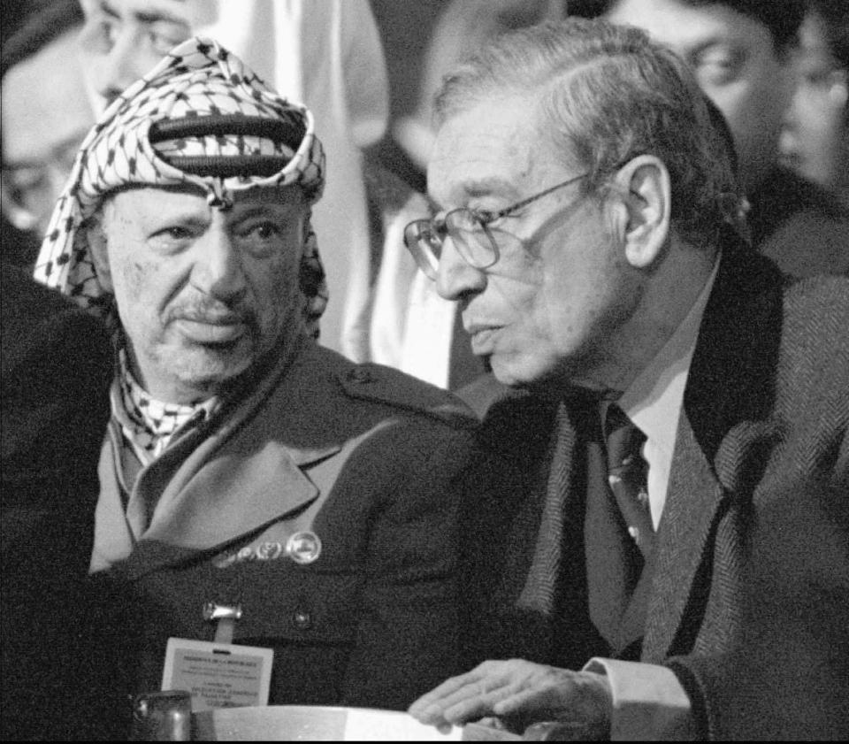 n this Jan. 11, 1996 file photo, Palestinian leader Yasser Arafat, left, and UN Secretary General Boutros Boutros-Ghali attend the funeral mass at Notre Dame Cathedral in Paris,where world leaders paid their last respects to former French President Francois Mitterrand. (Diether Endlicher/Pool photo via AP/File)