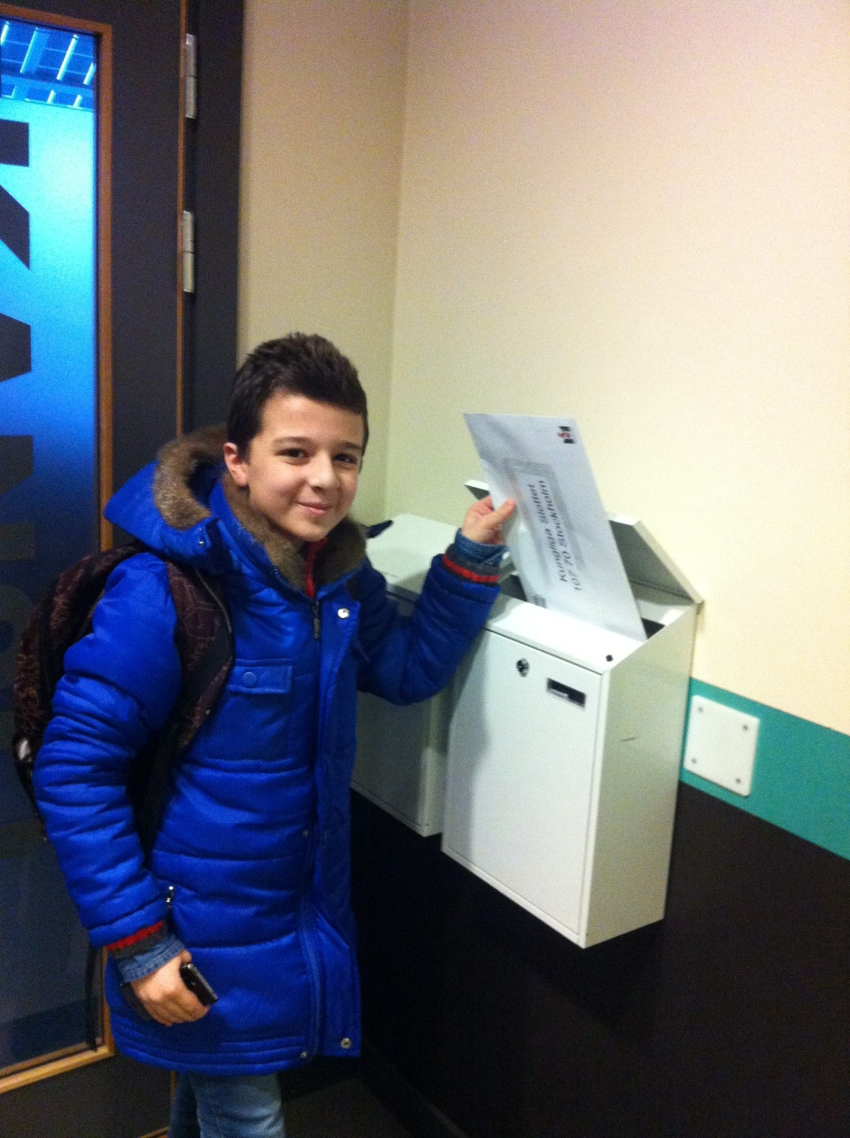 Twelve-year-old Syrian refugee boy Ahmed posts a letter to the Swedish king in Malmo, Sweden, Wednesday Feb. 3, 2016. (Pooja Sharafi via AP)