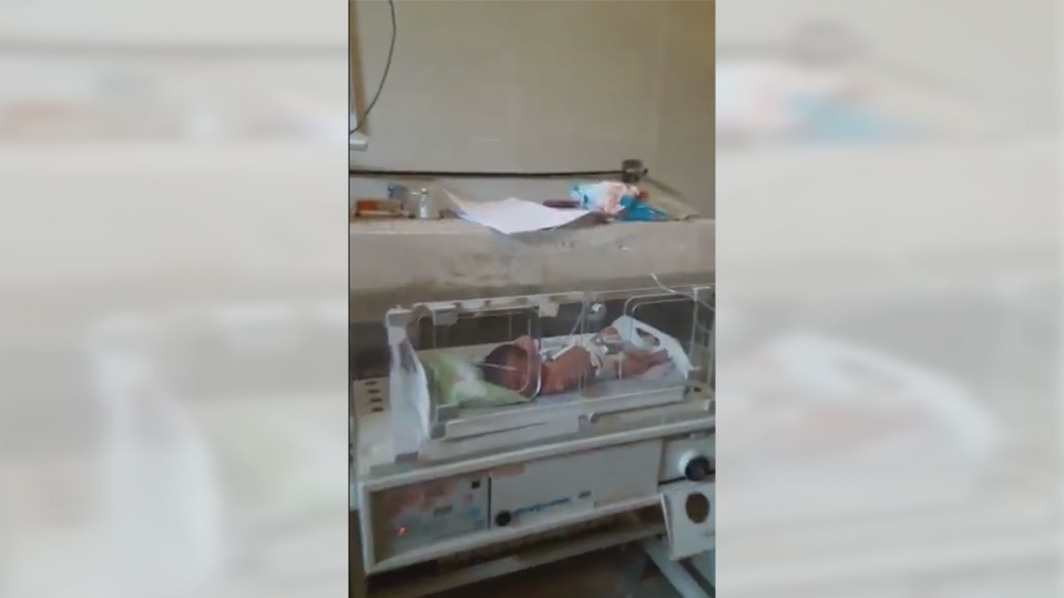 This screenshot from a video posted and shared by Syria Charity appears to show a baby lying in a neonatal ward in the town of Azaz, Syria (Twitter/@SyriaCharity)