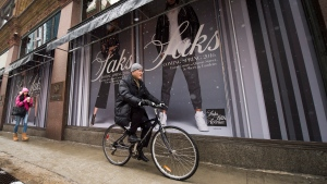 A cyclist rides past the new Saks Fifth Avenue store in downtown Toronto on Tuesday, February 16, 2016. THE CANADIAN PRESS/Nathan Denette