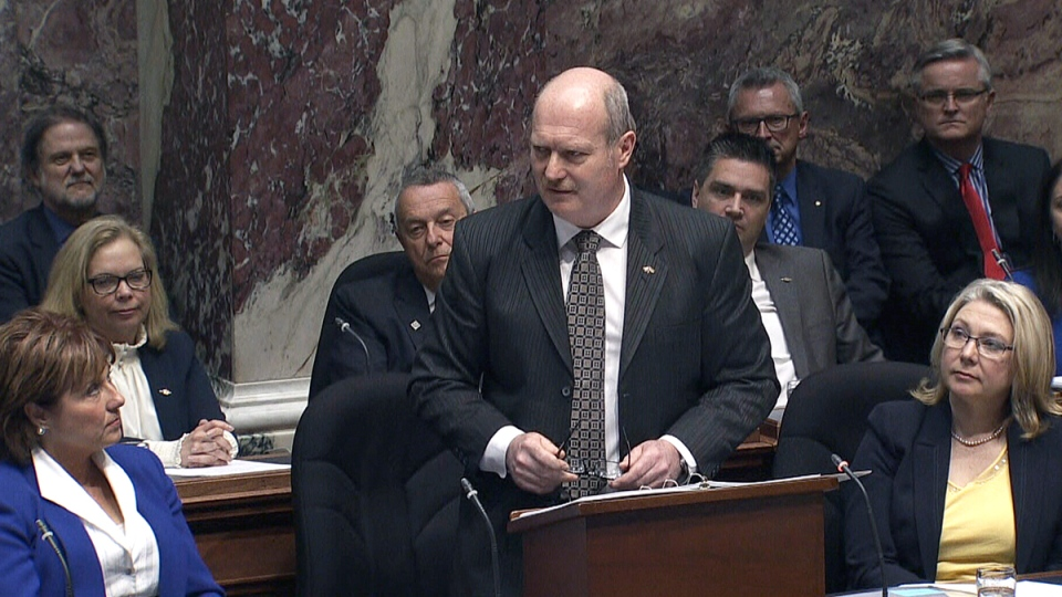 British Columbia Finance Minister Mike de Jong tables the province's budget at the provincial legislature in Victoria, Tuesday, Feb. 16, 2016.