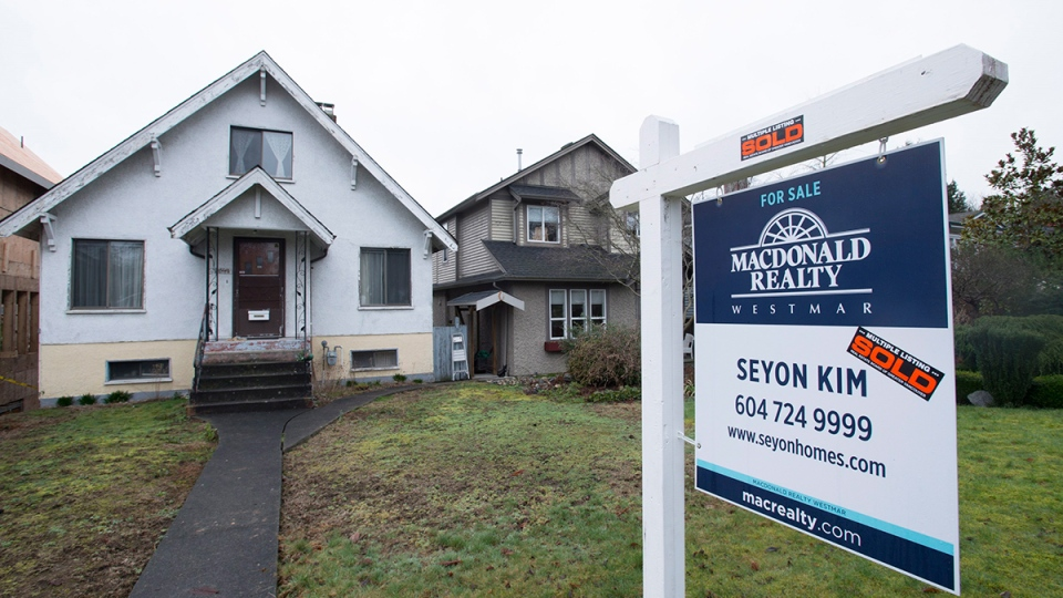 A sold home is pictured in Vancouver, Thursday, Feb. 11, 2016. (Jonathan Hayward / THE CANADIAN PRESS)
