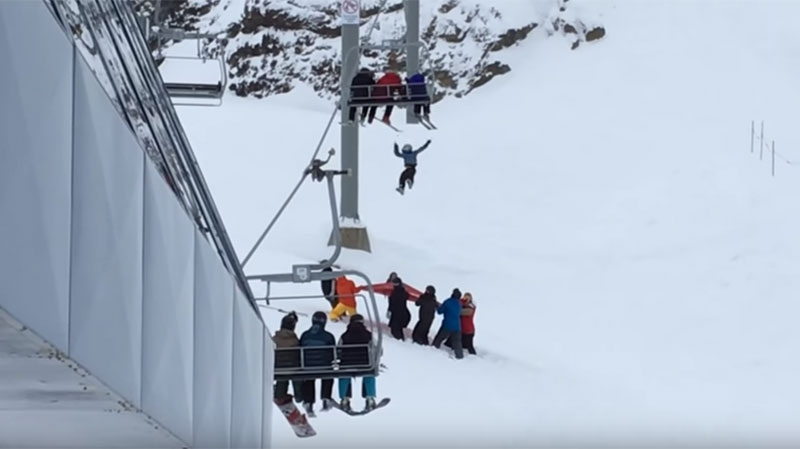 A young boy who was dangling from a Whistler chairlift landed safely thanks to staff and bystanders who broke his fall with a tarp. Feb. 16, 2016. (YouTube/Christopher Sakai)