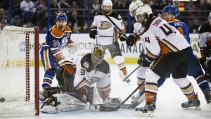 Anaheim Ducks' goalie Frederik Andersen reacts as Edmonton Oilers' Taylor Hall scores a goal during second period NHL action, in Edmonton on Tuesday, Feb. 16, 2016. (Codie McLachlan / THE CANADIAN PRESS)