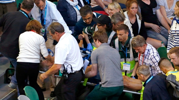 Nigel Sears is carried on a stretcher from Rod Laver Arena following a medical emergency at the Australian Open tennis championships on Jan. 23, 2016. (Rafiq Maqbool / AP)