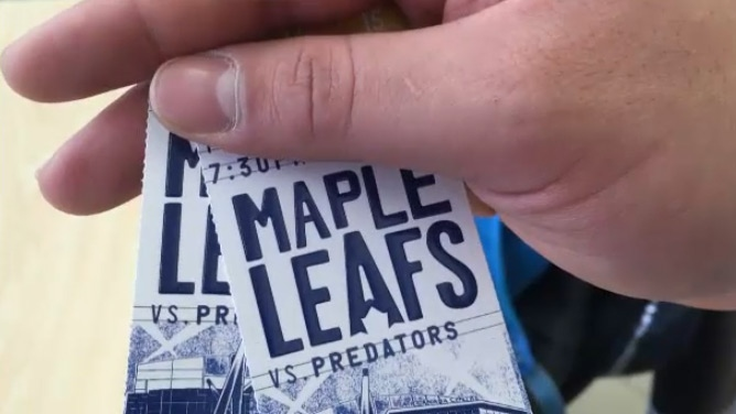 Nick Gambroudes holds a pair of Toronto Maple Leafs tickets on Tuesday, Feb. 17, 2016.