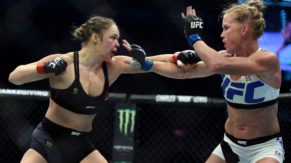 In this Sunday, Nov. 15, 2015 file photo, Ronda Rousey, left, and Holly Holm fight during their UFC 193 bantamweight title bout in Melbourne, Australia. (AP / Andy Brownbill, File)