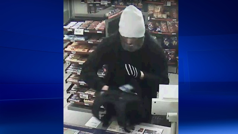 A male robbery suspect is caught on a security camera on Monday, February 15, 2016. (Courtesy London Police Service)