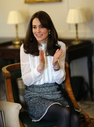 Kate, Duchess of Cambridge talks to children from the 'Real Truth' video blog that features on the Huffington Post website at Kensington Palace, London, Wednesday, Feb. 17, 2016. (Chris Jackson/Pool Photo via AP)