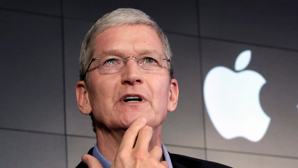In this April 30, 2015, file photo, Apple CEO Tim Cook responds to a question during a news conference at IBM Watson headquarters, in New York. (AP / Richard Drew, File)