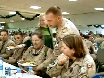 Officers serve Canadian soldiers a tradition Christmas dinner in Kandahar, Afghanistan, on Thursday, Dec. 25, 2008.