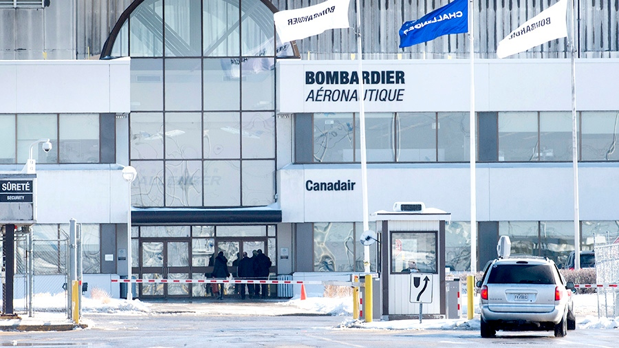 People enter a Bombardier plant, Wednesday, February 17, 2016 in Montreal. (THE CANADIAN PRESS / Paul Chiasson)