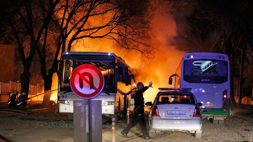 A police officer clears the area of an explosion in Ankara, Wednesday, Feb. 17, 2016. (Mustafa Kirazli / Cihan News Agency via AP)