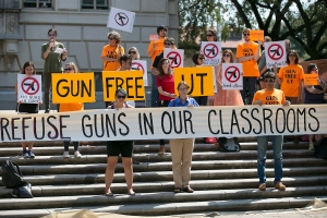 In this Oct. 1, 2015, file photo, protesters gather on the West Mall of the University of Texas campus to oppose a new state law that expands the rights of concealed handgun license holders to carry their weapons on public college campuses. (Ralph Barrera/Austin American-Statesman via AP)