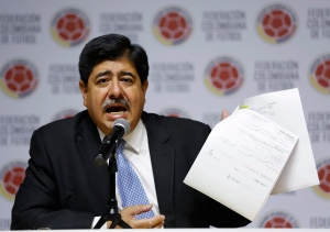 Luis Bedoya, president of Colombia's Football Federation, shows documents during a press conference at the federation's headquarters in Bogota, Colombia in this June 1, 2015 file photo. (AP /Fernando Vergara)