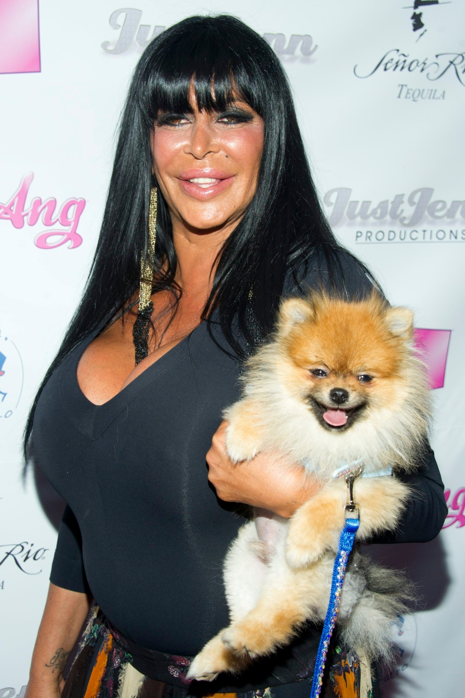 In this July 8, 2012, file photo, Angela Raiola, known as Big Ang, and her dog Little Louie arrive to the premiere of her VH1 reality show 'Big Ang' in New York. (Photo by Charles Sykes/Invision/AP, File)