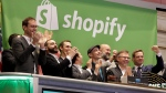 Shopify CEO Tobias Lutke, centre wearing hat, is celebrated as he rings the New York Stock Exchange opening bell, marking the Canadian company's IPO, on Thursday, May 21, 2015. (AP Photo/Richard Drew)