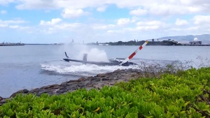 Image shows a civilian helicopter with five on board crashed onto the shores of Pearl Harbour on Thursday, Feb. 18, 2016 leaving one person in critical condition.
