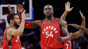 Toronto Raptors forward Patrick Patterson and guard Cory Joseph celebrate during the closing minutes of their 103-89 win over the Detroit Pistons during the second half of an NBA basketball game in Auburn Hills, Mich on Monday, Feb. 8, 2016. (AP / Carlos Osorio)