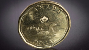 "A Canadian ""loonie"" one-dollar piece is pictured in North Vancouver, B.C., on Jan. 23, 2015. (Jonathan Hayward / THE CANADIAN PRESS)"