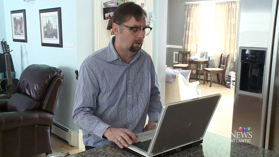 Duncan Campbell looks through job listings at his home in Westmount, N.S.