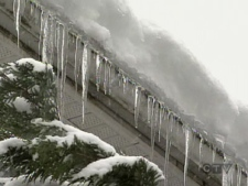 Snow accumulation and icicles are seen on a roof in Vancovuer, B.C., on Friday, Dec. 26, 2008.