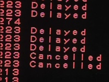 A board displays several delayed and canceled flights as a storm moves into B.C.'s Lower Mainland on Friday, Dec. 26, 2008.