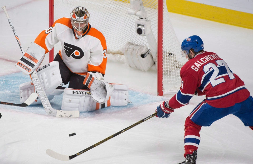 Montreal Canadiens' Alex Galchenyuk tries to get a shot away on Philadelphia Flyers goaltender Michal Neuvirth during second period NHL hockey action in Montreal, Friday, February 19, 2016. THE CANADIAN PRESS/Graham Hughes