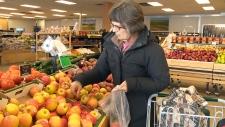 People shop for groceries in Edmonton