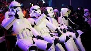 """In this Sunday, Dec. 27 photo, Chinese fans, dressed as Star Wars character Stormtroopers, gesture as they arrive for the premiere of """"Star Wars: The Force Awakens"""" in Shanghai, China. (AP Photo)"""