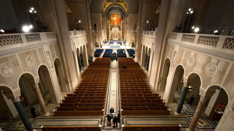 Ushers get ready for a funeral mass for the late Supreme Court Associate Justice Antonin Scalia at the Basilica of the National Shrine of the Immaculate Conception in Washington, Saturday, Feb. 20, 2016. (Doug Mills/The New York Times via AP, Pool)