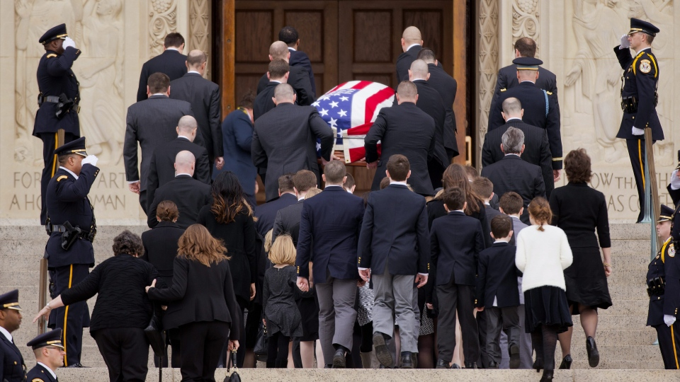 Family members follow behind the casket of the late Supreme Court Associate Justice Antonin Scalia as they arrive for a funeral mass at the Basilica of the National Shrine of the Immaculate Conception in Washington, Saturday, Feb. 20, 2016. (AP Photo/Pablo Martinez Monsivais)
