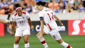 Canada's Christine Sinclair (12) celebrates after scoring a goal with Desiree Scott (11) against Costa Rica during the second half of a CONCACAF Olympic women's soccer qualifying championship semifinal Friday, Feb. 19, 2016, in Houston. Canada won 3-1. (AP Photo/David J. Phillip)