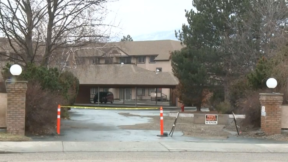 Tape and pylons block off the entrance to a condo building in Oliver, B.C.
