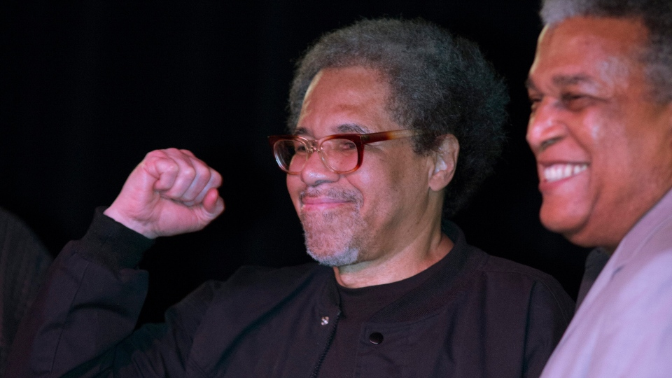 Albert Woodfox pumps his fist as he arrives on stage during his first public appearance at the Ashe Cultural Arts Center with Parnell Herbert, right, in New Orleans, Friday, Feb. 19, 2016 after his released from Louisiana State Penitentiary in Angola, La. earlier in the day. (AP Photo/Max Becherer)