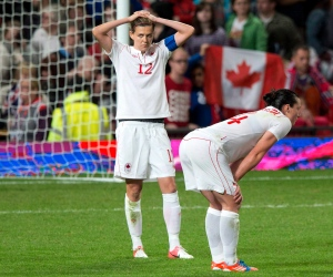 Canadian soccer players Christine Sinclair (12) and Melissa Tancredi react after losing 4-3 in extra time women's soccer action against the USA at the Olympic Games in London on Monday August 6, 2012. (Frank Gunn / The Canadian Press)